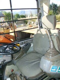 Экскаватор колесный Hitachi EX100WD 1992 года в Японии