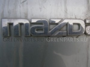 Эмблема на Mazda Demio DY3R, DY3W, DY5R, DY5W