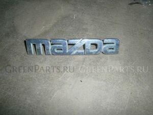 Эмблема на Mazda 2