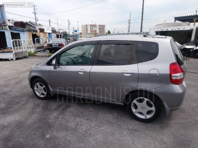 Обшивка багажника на Honda Fit GD1