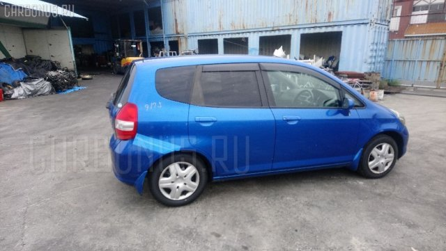 Амортизатор двери на Honda Fit GD1