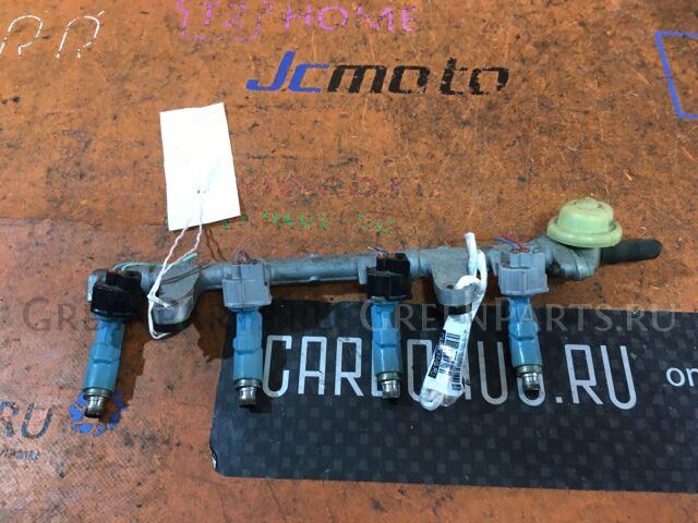 Форсунка инжекторная на Toyota Ractis SCP100 2SZ-FE