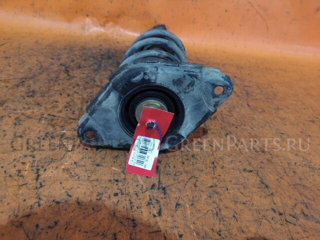 Стойка амортизатора на Nissan Sentra N16