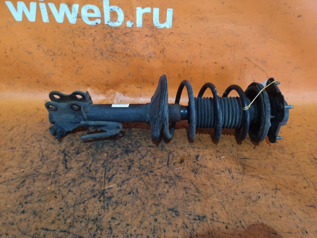 Стойка амортизатора на Toyota Raum EXZ10, EXZ15