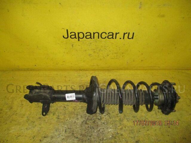 Стойка амортизатора на Mazda 323 BJ