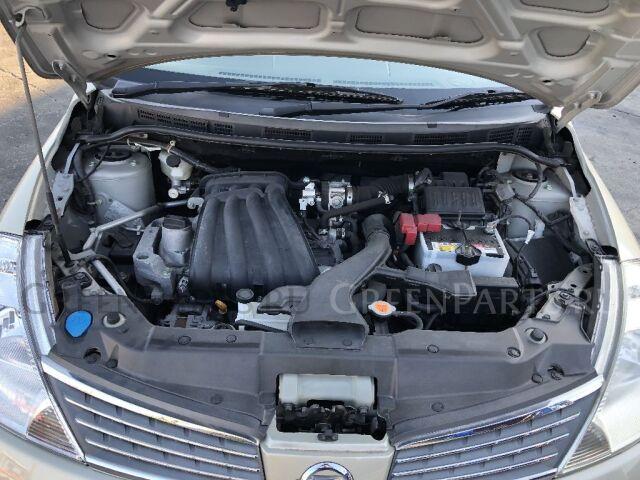 Стойка амортизатора на Nissan Versa C11