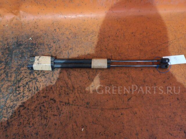Амортизатор двери на Nissan Wingroad WFY11