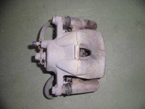 Суппорт на Toyota Vitz NCP95 2NZFE