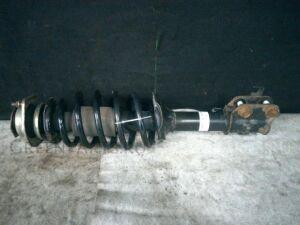 Стойка амортизатора на Toyota Duet M100A EJ-VE